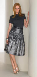 Matalan skirt and top. Half sleeve gathered roll neck £6, belt £3, embellished peplum skirt £16, metallic cross strap heels £14.